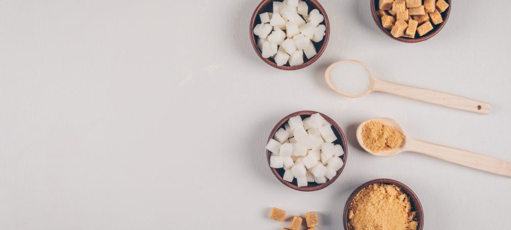 White and brown sugar cubes in bowls