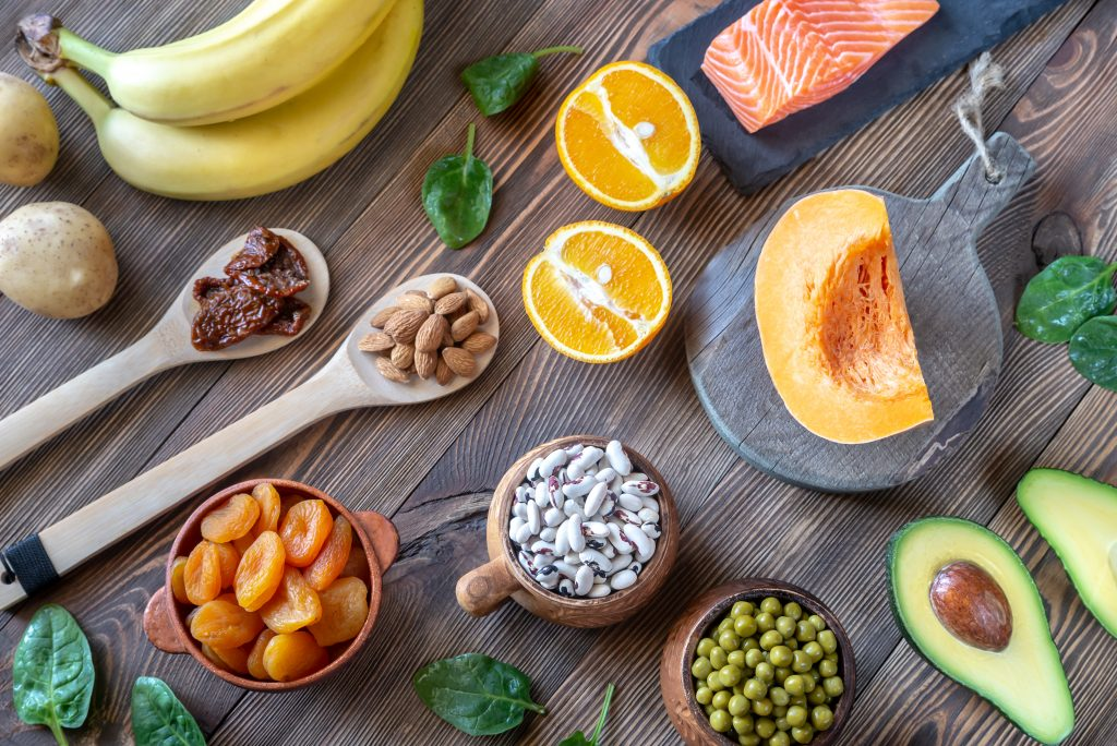 """alt=""""a spread of foods high in electrolytes including nuts, fruits, salmon, avocado"""""""